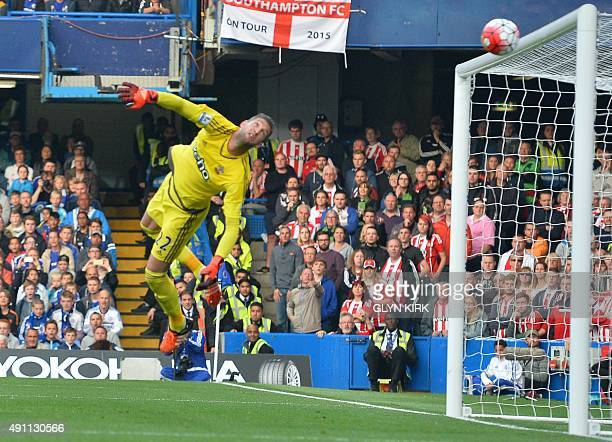 Southampton's Dutch goalkeeper Maarten Stekelenburg dives but can only watch as Willian's freekick goes into the top corner of his net for the...