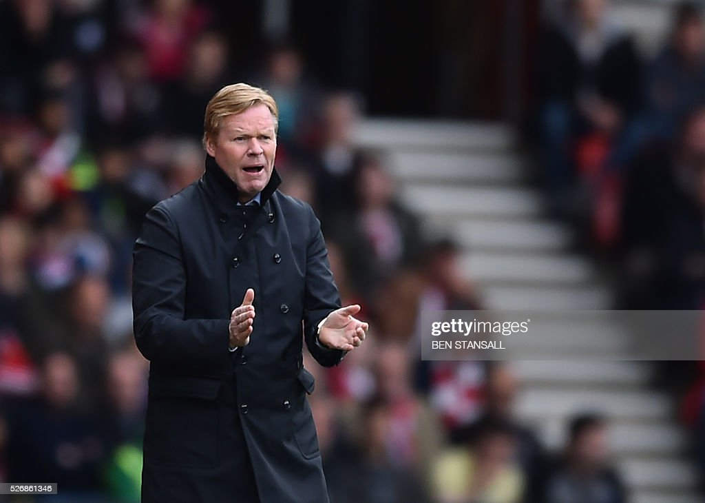 Southampton's Dutch manager Ronald Koeman claps during the English Premier League football match between Southampton and Manchester City at St Mary's Stadium in Southampton, southern England on May 1, 2016. / AFP / BEN STANSALL / RESTRICTED TO EDITORIAL USE. No use with unauthorized audio, video, data, fixture lists, club/league logos or 'live' services. Online in-match use limited to 75 images, no video emulation. No use in betting, games or single club/league/player publications. /
