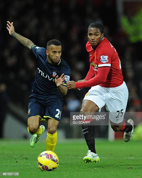 Southampton's English defender Ryan Bertrand chases Manchester United's Ecuadorian midfielder Antonio Valencia during the English Premier League...