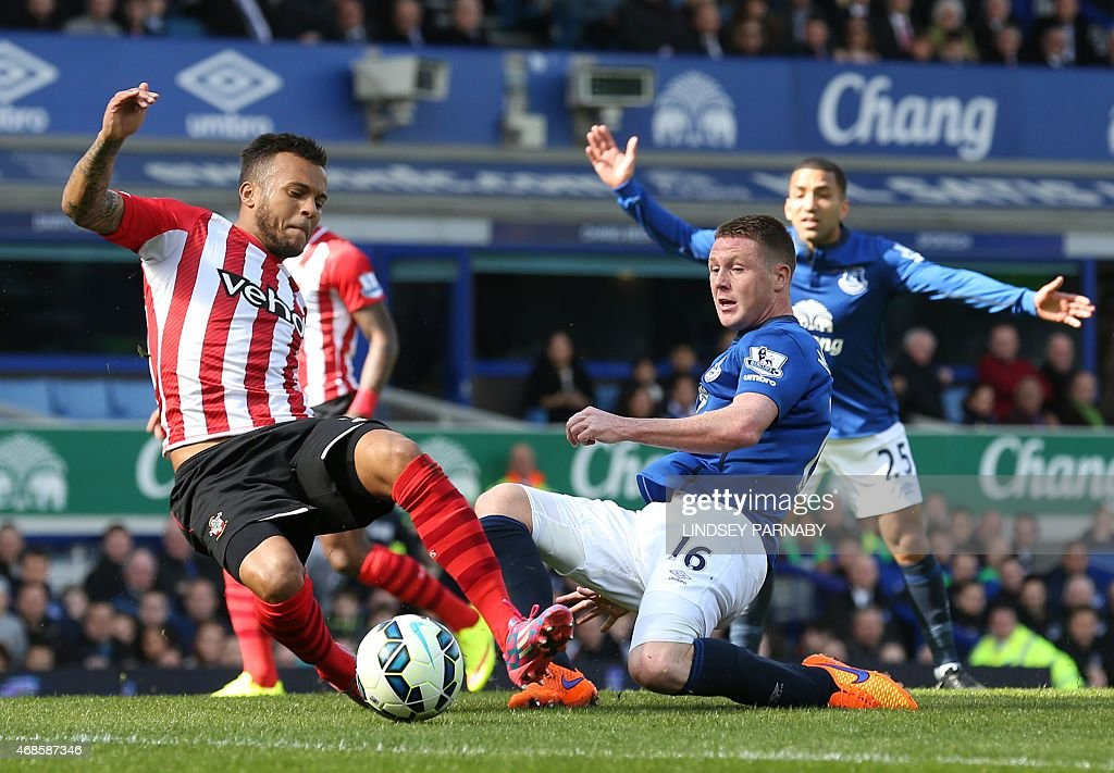 Southampton's English defender <a gi-track='captionPersonalityLinkClicked' href=/galleries/search?phrase=Ryan+Bertrand+-+Soccer+Player&family=editorial&specificpeople=1820135 ng-click='$event.stopPropagation()'>Ryan Bertrand</a> (L) vies with Everton's Scottish-born Irish midfielder <a gi-track='captionPersonalityLinkClicked' href=/galleries/search?phrase=James+McCarthy+-+Soccer+Player&family=editorial&specificpeople=8984734 ng-click='$event.stopPropagation()'>James McCarthy</a> during the English Premier League football match between Everton and Southampton at Goodison Park in Liverpool on April 4, 2015. USE. No use with unauthorized audio, video, data, fixture lists, club/league logos or live services. Online in-match use limited to 45 images, no video emulation. No use in betting, games or single club/league/player publications.