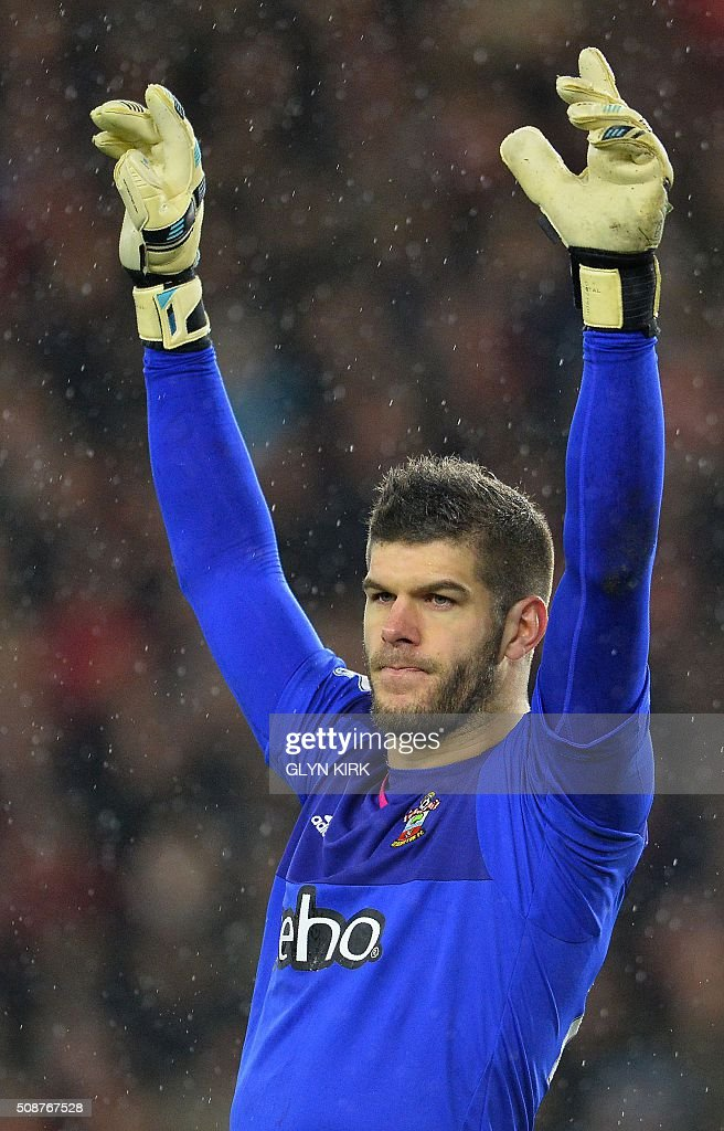 Southampton's English goalkeeper Fraser Forster gestures during the English Premier League football match between Southampton and West Ham United at St Mary's Stadium in Southampton, southern England on February 6, 2016. / AFP / GLYN KIRK / RESTRICTED TO EDITORIAL USE. No use with unauthorized audio, video, data, fixture lists, club/league logos or 'live' services. Online in-match use limited to 75 images, no video emulation. No use in betting, games or single club/league/player publications. /
