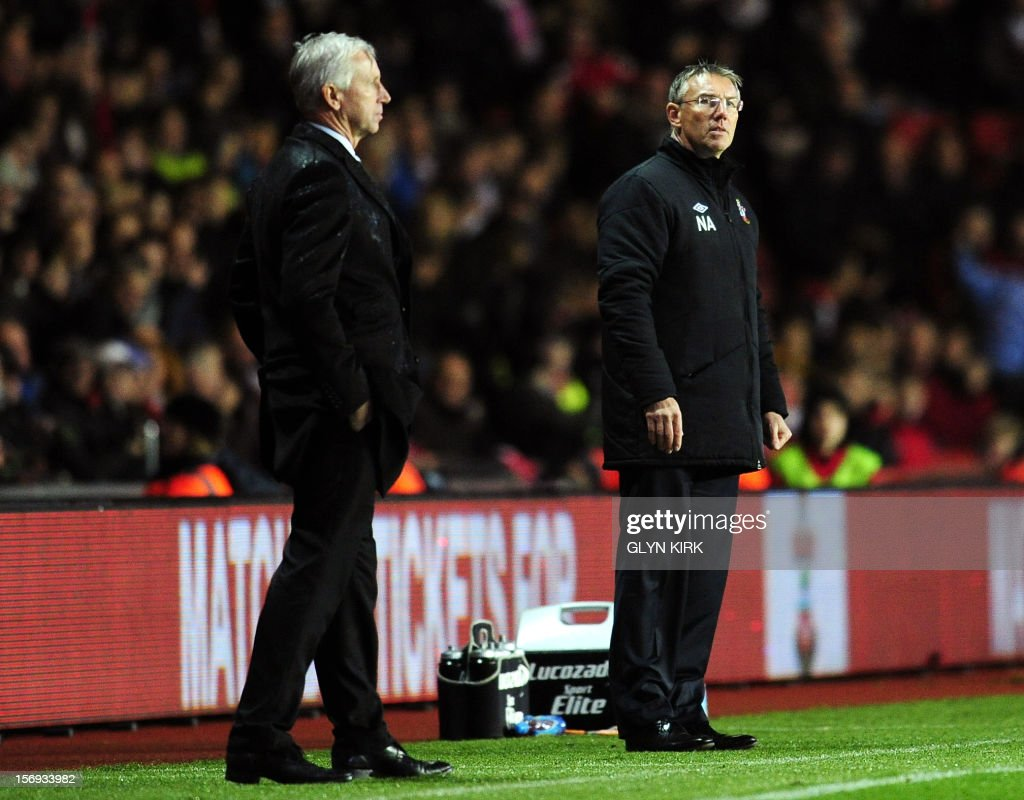"""Southampton's English manager Nigel Adkins (R) and Newcastle United's English manager Alan Pardew (L) stand on the sidelines during their English Premier League football match at St. Mary's Stadium, Southampton, southern England, on November 25, 2012. Southampton won the match 2-0. USE. No use with unauthorized audio, video, data, fixture lists, club/league logos or """"live"""" services. Online in-match use limited to 45 images, no video emulation. No use in betting, games or single club/league/player publications."""