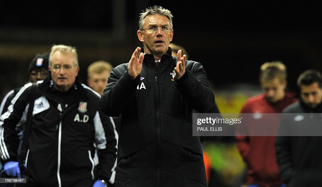 "Southampton's English manager Nigel Adkins leaves the field after the English Premier League football match between Stoke City and Southampton at The Britannia stadium, Stoke-on-Trent, England, on December 29, 2012. The game ended 3-3. USE. No use with unauthorized audio, video, data, fixture lists, club/league logos or ""live"" services. Online in-match use limited to 45 images, no video emulation. No use in betting, games or single club/league/player publications."