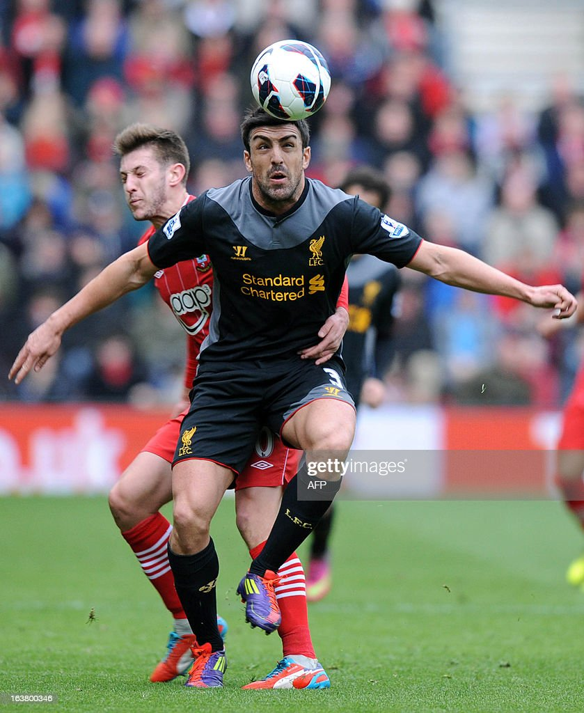 """Southampton's English midfielder Adam Lallana (L) vies with Liverpool's Luis Enrique during the English Premier League football match between Southampton and Liverpool at St Mary's Stadium in Southampton on March 16, 2013. Southampton won 3-1. AFP PHOTO/ Olly GREENWOOD - RESTRICTED TO EDITORIAL USE. No use with unauthorized audio, video, data, fixture lists, club/league logos or """"live"""" services. Online in-match use limited to 45 images, no video emulation. No use in betting, games or single club/league/player publications."""