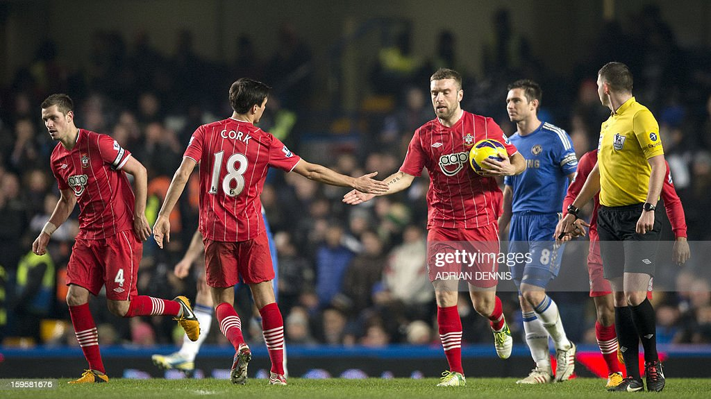 "Southampton's English midfielder Jack Cork (2nd L) congratulates teammate, English striker Rickie Lambert (3rd R) after Lambert scores their first goal during the English Premier League football match between Chelsea and Southampton at Stamford Bridge in London, on January 16, 2013. The game finished 2-2. AFP PHOTO/ADRIAN DENNIS USE. No use with unauthorized audio, video, data, fixture lists, club/league logos or ""live"" services. Online in-match use limited to 45 images, no video emulation. No use in betting, games or single club/league/player publications."