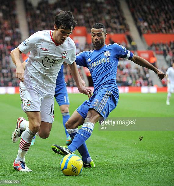 Southampton's English midfielder Jack Cork vies with Chelsea's English defender Ashley Cole during the English FA Cup third round football match...