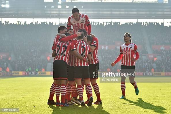 TOPSHOT Southampton's English midfielder James WardProwse celebrates with teammates after scoring the opening goal of the English Premier League...