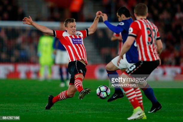 Southampton's English midfielder James WardProwse stretches for the ball against Manchester United's Armenian midfielder Henrikh Mkhitaryan during...