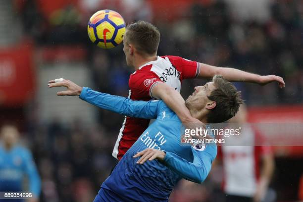 Southampton's English midfielder James WardProwse vies with Arsenal's Spanish defender Nacho Monreal during the English Premier League football match...