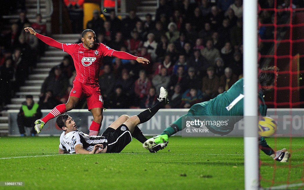 """Southampton's English midfielder Jason Puncheon (L) takes a shot at a goal against Newcastle during their English Premier League football match at St. Mary's Stadium, Southampton, southern England, on November 25, 2012. Southampton won the match 2-0. USE. No use with unauthorized audio, video, data, fixture lists, club/league logos or """"live"""" services. Online in-match use limited to 45 images, no video emulation. No use in betting, games or single club/league/player publications."""