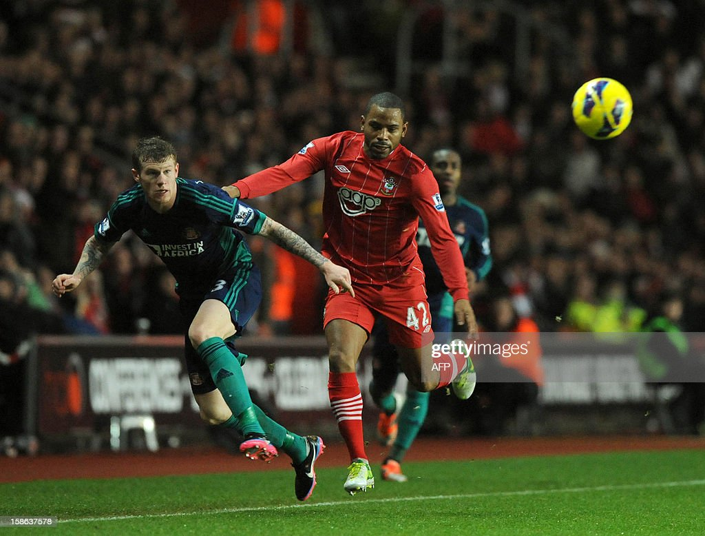 """Southampton's English midfielder Jason Puncheon (R) vies with Sunderland's Northern-Irish born Irish midfielder James McLean (L) during the English Premier League football match between Southampton and Sunderland at St Mary's Stadium in Southampton, southern England on December 22, 2012. Sunderland won the game 1-0. USE. No use with unauthorized audio, video, data, fixture lists, club/league logos or """"live"""" services. Online in-match use limited to 45 images, no video emulation. No use in betting, games or single club/league/player publications."""
