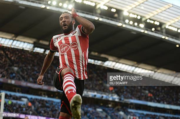 Southampton's English midfielder Nathan Redmond celebrates scoring the opening goal of the English Premier League football match between Manchester...