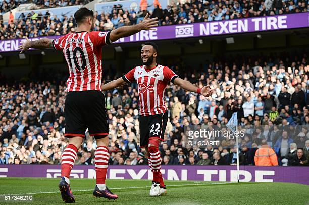 Southampton's English midfielder Nathan Redmond celebrates with Southampton's English striker Charlie Austin after scoring the opening goal of the...