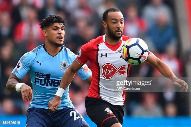 Southampton's English midfielder Nathan Redmond holds off Newcastle United's US defender DeAndre Yedlin during the English Premier League football...