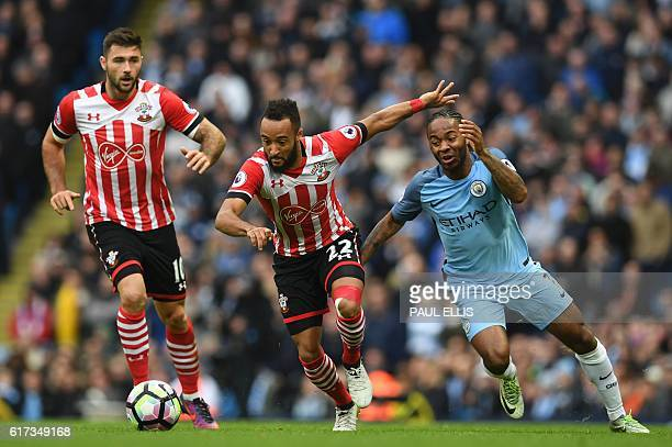 Southampton's English midfielder Nathan Redmond vies with Manchester City's English midfielder Raheem Sterling during the English Premier League...
