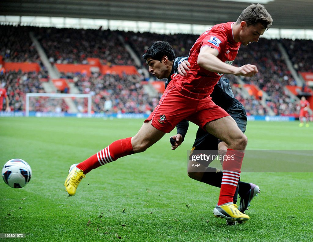 "Southampton's English player Adam Lallana (L) vies with Liverpool's Uruguayan striker Luis Suarez during the English Premier League football match between Southampton and Liverpool at St Mary's Stadium in Southampton on March 16, 2013. Southampton won 3-1. AFP PHOTO/ Olly GREENWOOD - RESTRICTED TO EDITORIAL USE. No use with unauthorized audio, video, data, fixture lists, club/league logos or ""live"" services. Online in-match use limited to 45 images, no video emulation. No use in betting, games or single club/league/player publications."