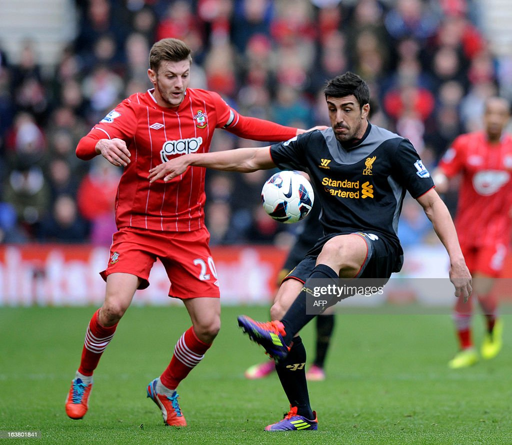 "Southampton's English player Adam Lallana (L) vies with Liverpool's Spanish defender Sanchez Jose Enrique during the English Premier League football match between Southampton and Liverpool at St Mary's Stadium in Southampton on March 16, 2013. Southampton won 3-1. AFP PHOTO/ Olly GREENWOOD - RESTRICTED TO EDITORIAL USE. No use with unauthorized audio, video, data, fixture lists, club/league logos or ""live"" services. Online in-match use limited to 45 images, no video emulation. No use in betting, games or single club/league/player publications."