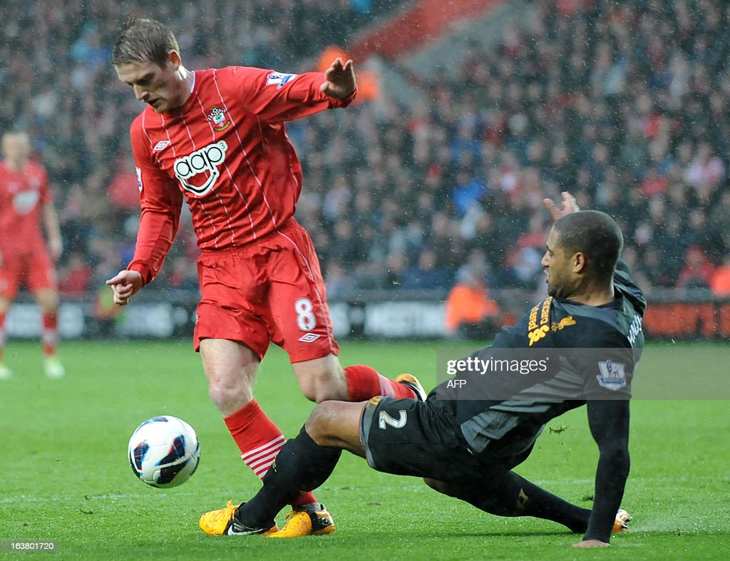 """Southampton's English player Steven Davis (L) vies with Liverpool's English defender Glenn Johnson during the English Premier League football match between Southampton and Liverpool at St Mary's Stadium in Southampton on March 16, 2013. Southampton won 3-1. AFP PHOTO/ Olly GREENWOOD - RESTRICTED TO EDITORIAL USE. No use with unauthorized audio, video, data, fixture lists, club/league logos or """"live"""" services. Online in-match use limited to 45 images, no video emulation. No use in betting, games or single club/league/player publications."""