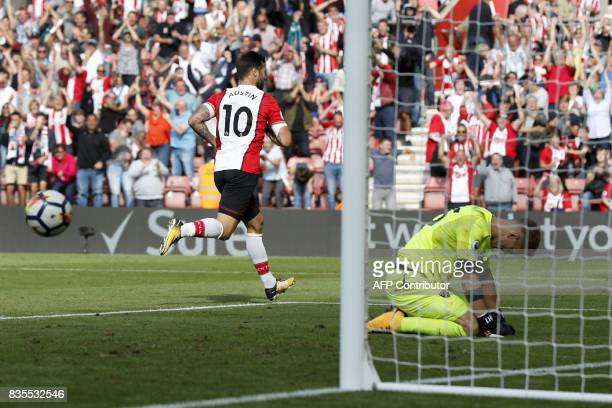 Southampton's English striker Charlie Austin celebrates taking the penalty to score the winning goal past West Ham United's English goalkeeper Joe...