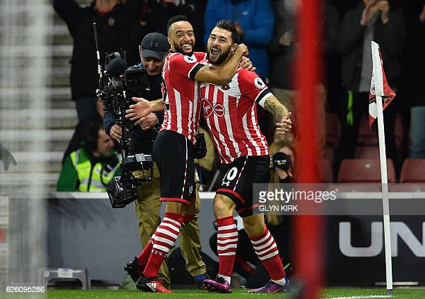 Southampton's English striker Charlie Austin celebrates with Southampton's English midfielder Nathan Redmond after scoring the opening goal in the...