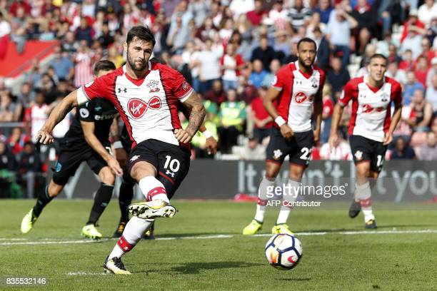Southampton's English striker Charlie Austin takes the penalty to score the winning goal during the English Premier League football match between...
