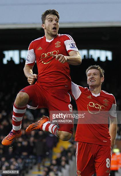Southampton's English striker Jay Rodriguez celebrates scoring a goal with teammate Northern Irish midfielder Steven Davis during the English Premier...