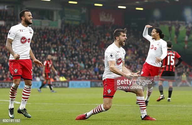 Southampton's English striker Jay Rodriguez celebrates scoring his team's second goal with Southampton's English defender Ryan Bertrand during the...