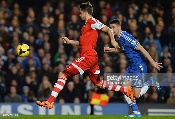 Southampton's English striker Jay Rodriguez is chased by Chelsea's English defender Gary Cahill as he scores the opening goal during the English...