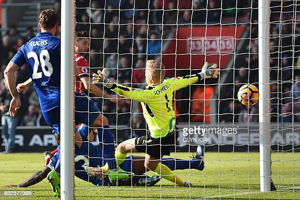 Southampton's English striker Jay Rodriguez scores their second goal past Leicester City's Danish goalkeeper Kasper Schmeichel during the English...