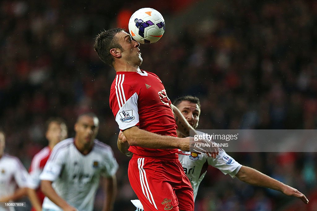 Southampton's English striker Rickie Lambert heads the ball during the English Premier League football match between Southampton and West Ham United at St Mary's Stadium in Southampton, southern England, on September 15, 2013. AFP PHOTO / ADRIAN DENNIS USE. No use with unauthorized audio, video, data, fixture lists, club/league logos or 'live' services. Online in-match use limited to 45 images, no video emulation. No use in betting, games or single club/league/player publications.