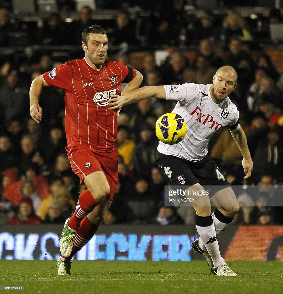 "Southampton's English striker Rickie Lambert (L) vies with Fulham's Swiss defender Philippe Senderos (R) during the English Premier League football match between Fulham and Southampton at Craven Cottage in London, England on December 26, 2012. The game finished 1-1. USE. No use with unauthorized audio, video, data, fixture lists, club/league logos or ""live"" services. Online in-match use limited to 45 images, no video emulation. No use in betting, games or single club/league/player publications"