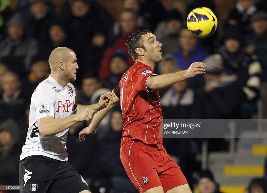 "Southampton's English striker Rickie Lambert (R) vies with Fulham's Swiss defender Philippe Senderos (L) during the English Premier League football match between Fulham and Southampton at Craven Cottage in London, England on December 26, 2012. The game finished 1-1. USE. No use with unauthorized audio, video, data, fixture lists, club/league logos or ""live"" services. Online in-match use limited to 45 images, no video emulation. No use in betting, games or single club/league/player publications"