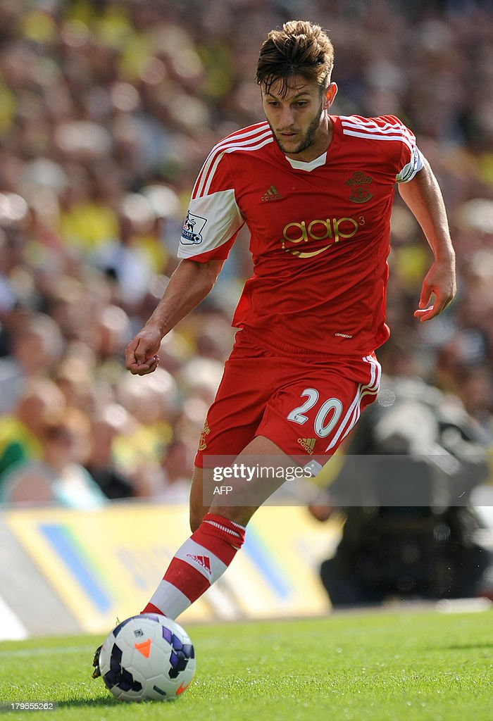 Southampton's Englishmidfielder Adam Lallana runs with the ball during the English Premier League football match between Norwich City and Southampton at Carrow Road in Norwich, eastern England on August 31, 2013. USE. No use with unauthorized audio, video, data, fixture lists, club/league logos or 'live' services. Online in-match use limited to 45 images, no video emulation. No use in betting, games or single club/league/player publications