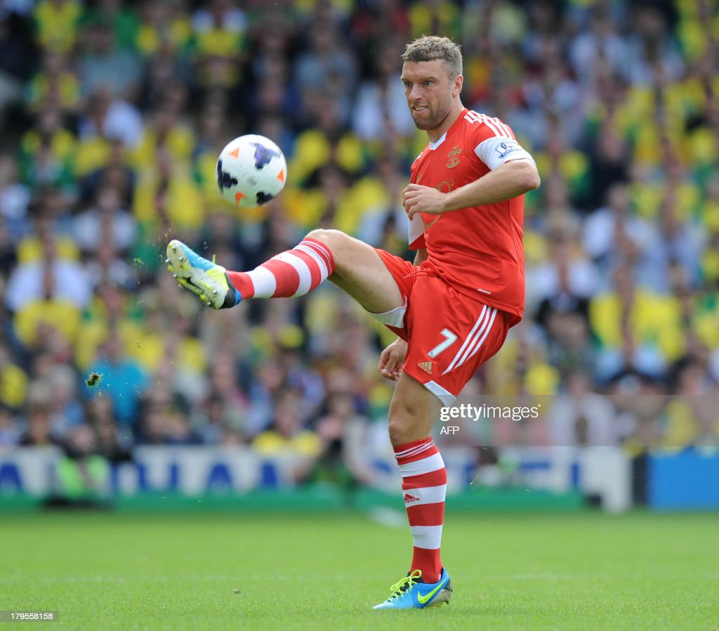 Southampton's Englishstriker Rickie Lambert passes the ball during the English Premier League football match between Norwich City and Southampton at Carrow Road in Norwich, eastern England on August 31, 2013. USE. No use with unauthorized audio, video, data, fixture lists, club/league logos or 'live' services. Online in-match use limited to 45 images, no video emulation. No use in betting, games or single club/league/player publications