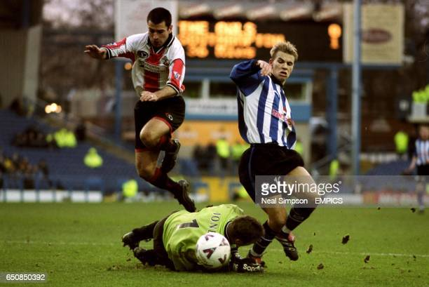 Southampton's Francis Benali leaps over goalkeeper Paul Jones as Sheffield Wednesday's Niclas Alexandersson tries to get a foot on the ball
