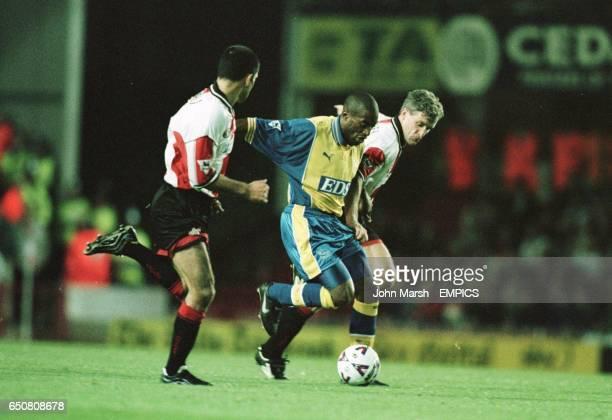 Southampton's Francis Benali Mark Hughes try to stop Derby's Dean Sturridge