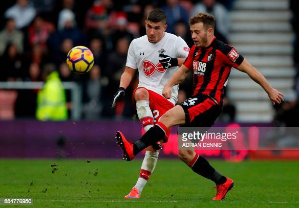 Southampton's French defender Jeremy Pied vies with Bournemouth's Scottish midfielder Ryan Fraser during the English Premier League football match...