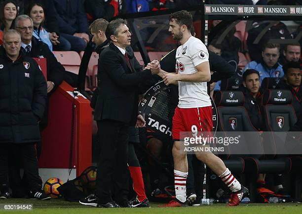 Southampton's French manager Claude Puel congratulates Southampton's English striker Jay Rodriguez following the English Premier League football...