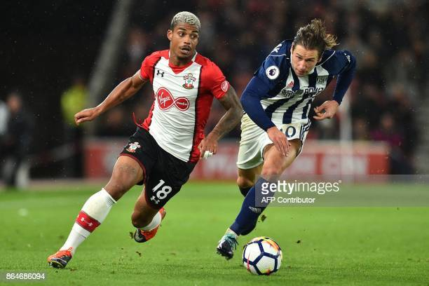 Southampton's Gabonese midfielder Mario Lemina vies with West Bromwich Albion's Polish midfielder Grzegorz Krychowiak during the English Premier...