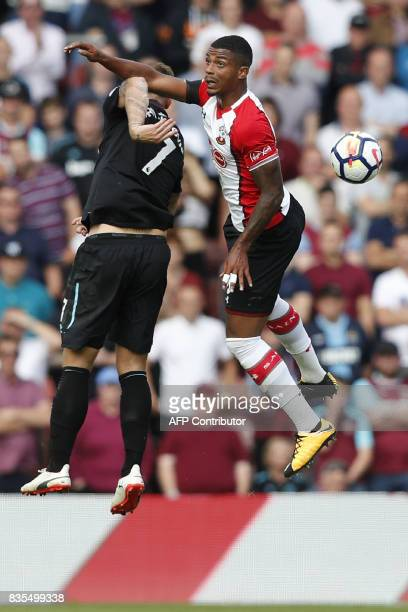 Southampton's Gabonese midfielder Mario Lemina vies with West Ham United's Austrian midfielder Marko Arnautovic during the English Premier League...