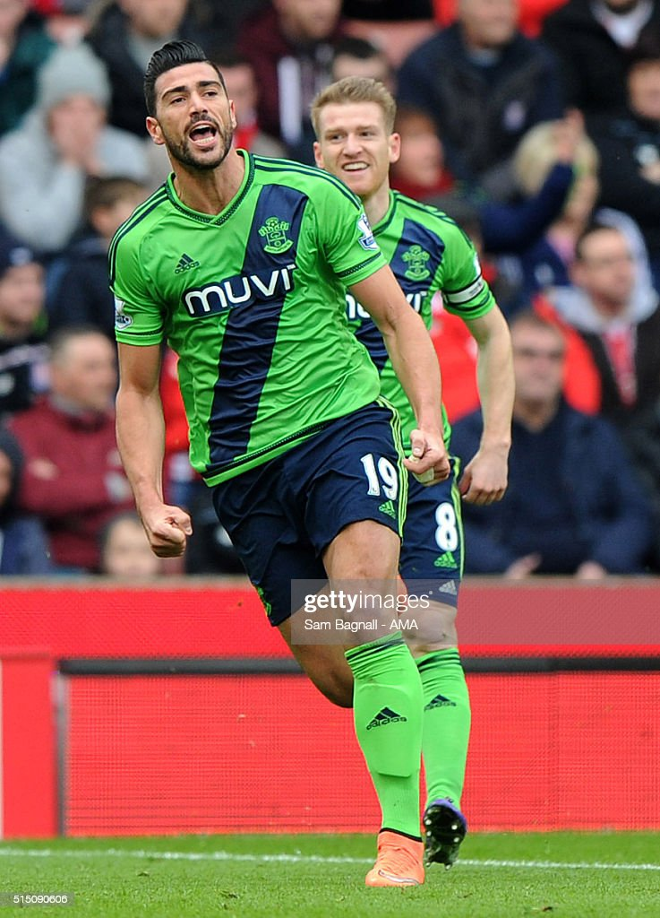 Southampton's <a gi-track='captionPersonalityLinkClicked' href=/galleries/search?phrase=Graziano+Pelle&family=editorial&specificpeople=2333390 ng-click='$event.stopPropagation()'>Graziano Pelle</a> celebrates after scoring a goal to make it 0-1 during the Barclays Premier League match between Stoke City and Southampton at Britannia Stadium on March 12, 2016 in Stoke on Trent, England.