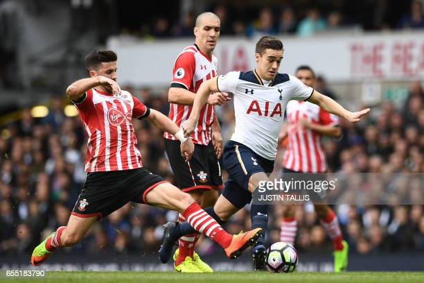 Southampton's Irish striker Shane Long tackles Tottenham Hotspur's English midfielder Harry Winks during the English Premier League football match...