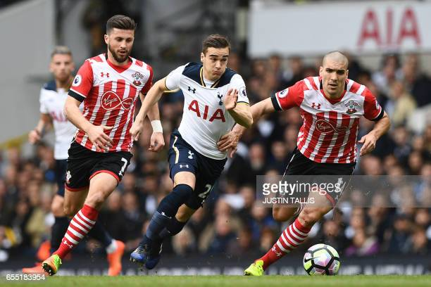 Southampton's Irish striker Shane Long Tottenham Hotspur's English midfielder Harry Winks and Southampton's Sepanish midfielder Oriol Romeu run for...