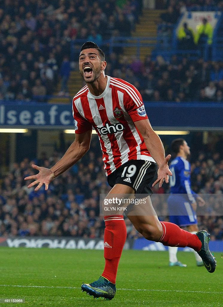 Southampton's Italian striker Graziano Pelle celebrates after scoring their third goal during the English Premier League football match between Chelsea and Southampton at Stamford Bridge in London on October 3, 2015. Southampton won the game 3-1. USE. No use with unauthorized audio, video, data, fixture lists, club/league logos or 'live' services. Online in-match use limited to 75 images, no video emulation. No use in betting, games or single club/league/player publications.