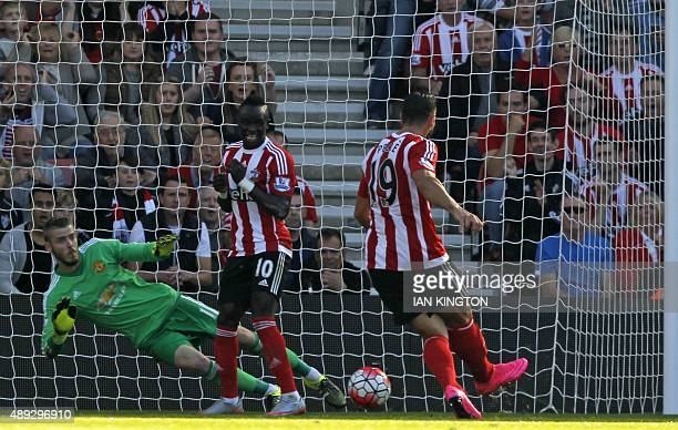 Southampton's Italian striker Graziano Pelle scores their opening goal past Manchester United's Spanish goalkeeper David de Gea duringthe English...