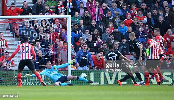 Southampton's Italian striker Graziano Pelle scores their second goal during the English Premier League football match between Southampton and Hull...
