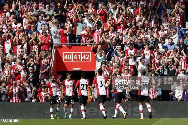 Southampton's Italian striker Manolo Gabbiadini celebrates with teammates scoring his team's first goal during the English Premier League football...