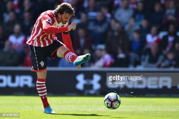 Southampton's Italian striker Manolo Gabbiadini has a shot but is flagged for offside during the English Premier League football match between...