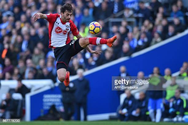 Southampton's Italian striker Manolo Gabbiadini leaps to control the ball during the English Premier League football match between Brighton and Hove...