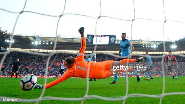 Southampton's Italian striker Manolo Gabbiadini scores their first goal during the English Premier League football match between Southampton and...